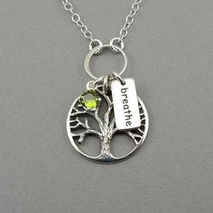 Sterling silver Tree of Life charm necklace accented with a gemstone of your color choice set in a crown bezel setting and a breathe word tag. The Tree pendant is 1 long. All jewelry parts are 925 solid sterling silver. Gemstones are top quality lab created with a special faceted cut for a