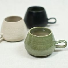 Designed and hand-thrown by ceramicist Jered Nelson in Berkeley, California, who makes functional and modern dinnerware in stoneware with local clay. These stoneware pieces are durable and simple enough for everyday use.  The stoneware mug fits snugly in your hand for enjoying your favorite hot beverage. The interior rim highlights the beautiful glaze colors as they blend into the natural clay.