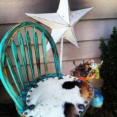 Rustic turquoise chair with cowhide upholstery