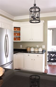 LOVE this makeover!!!  Love the added molding to top of cabinets painted white!  Love taking door off corner cabinet & using baskets! Must do this in our kitchen