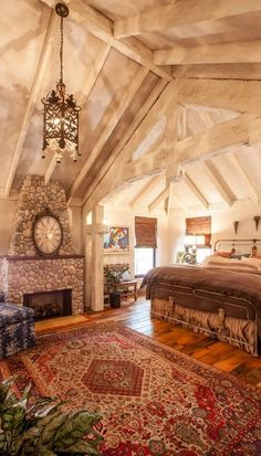 Beautiful Bedroom ~ Love everything from the rug and flooring to the chandelier and pitched ceiling.