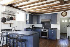 rustic colonial style kitchen with blue cabinets