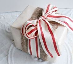White wrapping paper, burlap and coloured ribbon to suit holiday