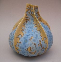Last night I dreamt I was loading a kiln with vases decked in crystaline glaze... I kept messing up and touching the vessels after crystals had begun to form on the surface causing me to rinse the vases and start all over again and again and again... I wonder what that means. {beautiful work from Yves Lambeau}