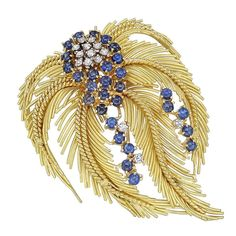 Sapphire Diamond Gold Feather Brooch | From a unique collection of vintage brooches at https://www.1stdibs.com/jewelry/brooches/brooches/