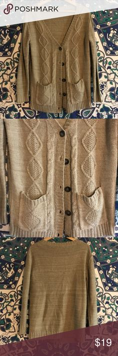 Tan Button Up Cardigan Chunky knit cardigan with big buttons and front pockets. Pairs perfect with knee high boots or ripped jeans! Tan/cream colored and comfortable fabric. Charlotte Russe Sweaters Cardigans