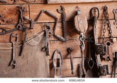 Assorted old work tools on wooden wall