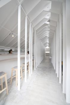 Ladders lead to capsule-sized bedrooms in Koyasan Guesthouse by Alphaville Architects