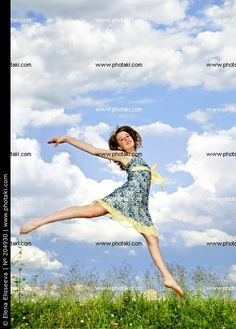 http://www.photaki.com/picture-girl-jumping-in-a-meadow-flowers-natural_204930.htm