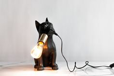 For all the dog lovers, meet Frenchie, an elegant desk lamp that is sure to put a smile on your face. A future classic by Rialheim. Desk Lamp, Table Lamp, Small Moments, Game Room, Living Room Designs, Dog Lovers, In This Moment, Meet, Smile