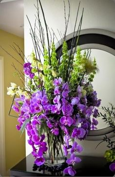 Floral Arrangement ~ purple orchids and green bells of ireland / flourishdesigns.com shannon