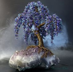 Blue and purple wisteria inspired bead and wire tree sculpture on an amethyst crystal cluster. Handmade by Twysted Roots award winning handmade bead and wire tree sculptures, unique gifts, decorative item for home. Wire Crafts, Bead Crafts, Crystal Tree, Crystal Cluster, Amethyst Cluster, Bonsai Wire, Purple Wisteria, Wire Tree Sculpture, Seed Beads