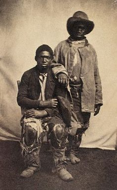 "ca. 1862-1863, USA --- Two escaped slaves, ""intelligent contrabands"" in the language of the times, posed for this portrait in 1862 or 1863. Many escaped slaves found employment as servants for Federal soldiers and officers. --- Image by © CORBIS"