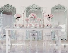 Ghost chairs teamed with pretty pinks and venetian mirrors....Big love!