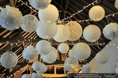 White paper lanterns with lace lanterns and pom poms for super-pretty wedding lighting at the barn at Ufton Court