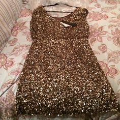 Gold cocktail dress Gold sequence make this an elegant dress to wear to a party or wedding.  Very comfortable material inside so the sequence does not bother you.  Very flirty dress! Aidan Mattox Dresses