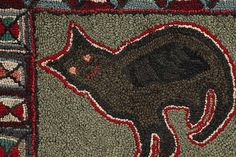 hooked rug of a Kitten -   American, early 20th century  Mixed fabrics on burlap  26 x 43 inches    This charming hooked rug features a very appealing, naively executed kitten at the center, surrounded by a square, log-cabin type border. This rug is a very strong folk art image and retains its vibrant colors.