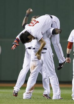 Boston Red Sox's David Ortiz lifts Koji Uehara  after Game 2 of the American League baseball championship series against the Detroit Tigers ...