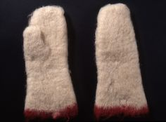 mittens, nalbound, made by Hottinen Josefiina,  1929,  The National Museum of Finland, nalbound mittens made from white woolen yarn. The mittens are otherwise solid color, but the mouth is a red border. The mittens are heavily felted and blunt ; käsineet, neulakintaat, Hottinen Josefiina 1929, The National Museum of Finland Valkoisesta villalangasta tehdyt neulakintaat. Kintaat ovat muuten yksiväriset, mutta niiden suussa on punainen reunus. Kintaat ovat voimakkaasti vanutetut ja…