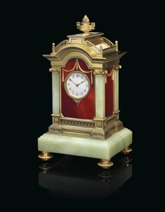 A HIGHLY IMPORTANT AND IMPRESSIVE SILVER-GILT AND GUILLOCHÉ ENAMEL BOWENITE MANTEL CLOCK MARKED FABERGÉ WITH THE IMPERIAL WARRANT, WITH THE WORKMASTER'S MARK OF JULIUS RAPPOPORT, ST PETERSBURG, 1899-1904, SCRATCHED INVENTORY NUMBER 7532 Estimate GBP 300,000 - GBP 500,000 (USD 389,400 - USD 649,000)