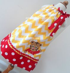 Daniel Tiger Inspired Yellow & Red Chevron pillowcase dress. Perfect for a Daniel Tiger birthday party for baby, toddler, or little girls.