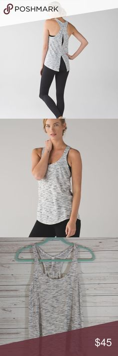 Salute The Sun Tank 4 HGRY Heathered Gray Tank Top Salute The Sun Tank 4 HGRY Heathered Gray Color Tie Back Luon $58  Excellent condition, comes as shown, no damage.   This lightweight tank goes with the flow—tie it up for Handstand or wear it loose for extra air. Seriously Light™ Luon Our sweat-wicking, four-way stretch Seriously Light™ Luon fabric makes moving a breeze seriously lightweight sweat-wicking four-way stretch cottony-soft lululemon athletica Tops Tank Tops