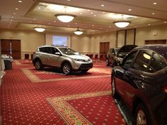 Ballroom with 4 SUV's in it