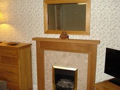 """Sent in by Denene Kerr. The Cheltenham Solid Oak Fireplace Surround. """"""""Superb customer service (honouring a sale price I'd seen some weeks earlier but forgot to order in time). Our bespoke sizes were supplied on the Tuesday, and our solid oak fire surround arrived on the Friday morning"""" - Denene Kerr Oak Fire Surround, Steps Design, Friday Morning, Fireplace Surrounds, Solid Oak, Customer Service, Contemporary Style, Bespoke, Tuesday"""