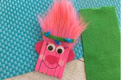 This Trolls Poppy Popsicle Stick Craft for Kids will have you thinking it's all cupcakes...