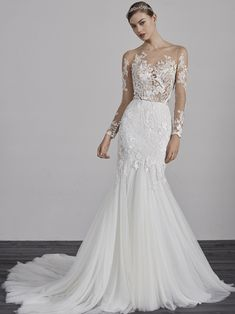 3ed71521934 Sensual mermaid wedding gown with illusion bodice and sleeves.  pronovias   bridal  bride