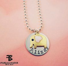 This charming gold baby elephant has a pink heart for an ear and sits atop a silver pendant with a hand-stamped name. Four-sided silver bar necklace hand-stamped with whatever you'd like: name/birthdate/time born, baby's weight, for a new mom. ♥ Or a name, graduation date, high school, mascot, etc for grad. ♥ Or special words that are meaningful to you: family, blessed, love, faith, etc. ♥ Perfect for a birthday, valentines day or christmas gift!  Four-sided silver bar necklace hand-stamped…