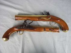 Here is a nice pair of flint locks.  Bet it would be cool to shoot them.