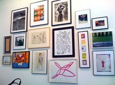 """Group all your art and photographs into a """"gallery wall"""" display. 