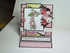 (Ref:H13) LOTV stamp, Nitwit papers - Perfect Pair, La La Land stitched tab die for the bundle of joy stamp and various dies used to create the flowers.