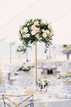 Combining the Ease of a Beach Affair with the Elegance of the Big City is part of Tall wedding centerpieces - With sailcloth tents and wide planked floors built just for this celebration, this beach affair is as elegant and glamorous as they come Beach Wedding Centerpieces, Beach Wedding Reception, Beach Wedding Flowers, Wedding Venue Decorations, Wedding Flower Arrangements, Flower Centerpieces, Floral Wedding, Wedding Bouquets, Rustic Wedding