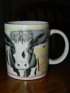 A Vintage Cow Coffee CupCollectible Black & White Ceramic Cow