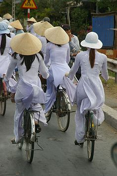 Vietnam- high school girls wear these uniforms to school. In one village I drove through on my travels in Vietnam these uniforms were pale pink with a small floral design thoughout the silk like fabric. It was striking to see so many girls after school ended in the afternoon, walking and riding bikes en masse in their beautiful pale pink matching uniforms.