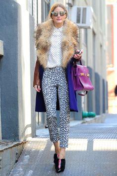 526f4a72f4d6f Olivia Palermo proves that mismatched prints can still look polished. Pair  black-and-white dots with spots