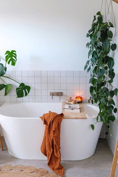 Oversized white tub with matching white subway tile makes this an inviting bathroom. And of course, add plants for a touch of green and you have a dreamy bathroom. whitetilebathroom minimalistbathroom Photo by 538180224220154543 White Bathroom Tiles, Modern Master Bathroom, Bathroom Plants, Minimalist Bathroom, Master Bathrooms, Bathroom Mirrors, Bathroom Cabinets, Shower Tiles, Marble Bathrooms