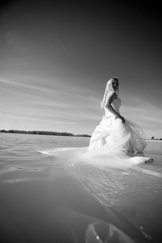 A pose I want! (but not IN my actual wedding dress-just in a white goodwill dress or something). Will take in Lake Erie