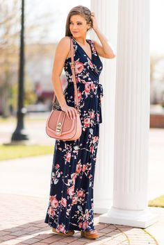 """Your Very Own Love Song Maxi Dress, Navy""This dress looks and feels like your own personal love song! The maxi dress has a flattering wrap look but non of the worries that it might come undone! #newarrivals #shopthemint"