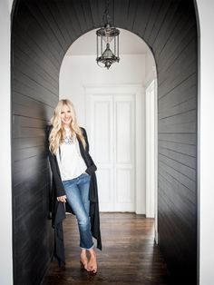 """When Holly Williams and her husband, Chris Coleman, a musician and artist, began house hunting in 2011, they faced a challenge: They loved the openness of their downtown Nashville loft but craved the charm of a historic home. """"One night, I had a dream that we'd find an airy, historic place with a double fireplace, so the moment we spotted this one connecting the kitchen and dining area, we knew we'd found our home."""" Using a mix of carefully chosen pieces, neutral colors, and treasured…"""