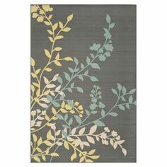 """Anchor your patio seating group or define space in the den with this loomed indoor/outdoor rug, featuring a leafy vine motif for natural appeal.  Product: RugConstruction Material: PolypropyleneColor: Dark grey and light blueFeatures: Suitable for indoor and outdoor usePower-loomedPile Height: 0.25""""Note: Please be aware that actual colors may vary from those shown on your screen. Accent rugs may also not show the entire pattern that the corresponding area rugs have.Cleaning and Care: ..."""