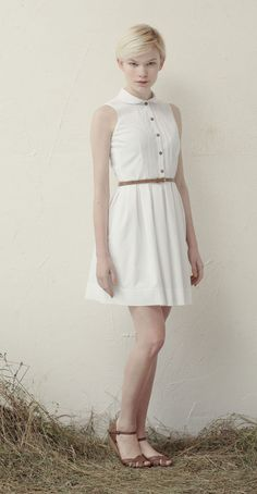 RONETTE White: Sleeveless dress, rounded collar, decorative lace, pleated skirt.  Betina Lou Spring-Summer 2013