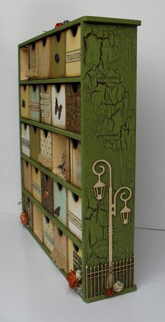 I really love this storage idea. I'll never do it because I have job, no patience, and a very low level of artistic ability, but it is crafty and cute.