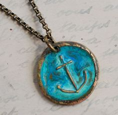 hope anchor wax seal necklace in a patinated aqua bronze. $42.00, via Etsy.