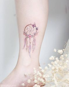 Dreamcatcher tattoo on the ankle.