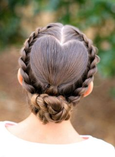 ROMANTIC HEART HAIRSTYLES: Here are 7 hairstyles perfect for Valentine's Day or any date night. Here you'll learn fun and totally unique ways to make your hair look like the most romantic thing ever — a pretty heart! These sweet styles are both pretty and sexy. Click through for the romantic heart hair ideas featuring braids, buns, and more.