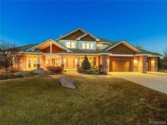 This home's incredible exterior lighting makes it welcoming and beautiful. Boulder, CO Coldwell Banker Residential Brokerage