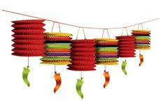 Brighten up any fiesta party with our Fiesta Lantern Garland. Garland features accordion paper lanterns in hot fiesta colors with green and red chili pepper foil cutouts dangling below. Lantern garland measures 12 foot.